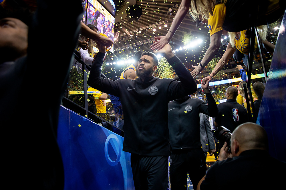 Golden State Warriors center JaVale McGee (1) greets fans as he exits to the locker room following the end of the fourth quarter of Game 2 of the NBA Western Conference semifinals between the Golden State Warriors and New Orleans Pelicans at Oracle Arena, Tuesday, May 1, 2018, in Oakland, Calif. The Warriors won 121-116.
