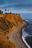 Point Vicente Lighthouse and sunset light on coastal cliffs at Point Vicente, Palos Verdes Peninsula, California