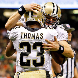 September 23, 2012; New Orleans, LA, USA; New Orleans Saints quarterback Drew Brees (9) celebrates with running back Pierre Thomas (23) during the second quarter of a game against the Kansas City Chiefs at the Mercedes-Benz Superdome. Mandatory Credit: Derick E. Hingle-US PRESSWIRE