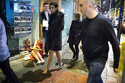 © Licensed to London News Pictures . 01/01/2015 . Manchester , UK . A woman eats a takeaway from a sitting position on the pavement . Revellers usher in the New Year on a night out in Manchester City Centre .  Photo credit : Joel Goodman/LNP