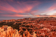 Fiery pink sunset at Bryce National Park. It is an amazing thing to see how this canyon lights up after the sun sinks low enough to throw the canyon into shadow.  Before this the bright sun washed out all the color.