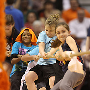 Youngsters take part in a tug of war contest during a time out during the Connecticut Sun Vs Phoenix Mercury WNBA regular season game at Mohegan Sun Arena, Uncasville, Connecticut, USA. 23rd May 2014. Photo Tim Clayton