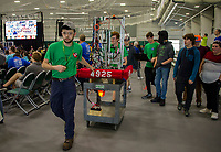"Team Resistance of Kingswood High School, Wolfboro bring their robot ""Opportunity"" to the play area for qualifying rounds during the Governor's Cup FirstNH Robotics Competition held in All Well North complex of PSU on Saturday.  Drive team members Hunter Wrigley, Isaac Garry, Ethan Anderson, Arron Stanard and Xavier Brownell. (Karen Bobotas/for the Laconia Daily Sun)"