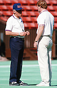 (L-R) The American Football Conference Buffalo Bills head coach Marv Levy talks to NFL executive and future NFL Commissioner Roger Goodell while the team practices during the week of the 1989 NFL Pro Bowl football game against the National Football Conference on Jan. 24, 1989 in Honolulu. The NFC won the game 34-3. (©Paul Anthony Spinelli)