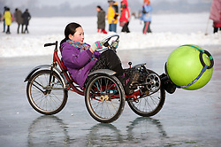 Children playing on frozen Songhua River during winter in Harbin China