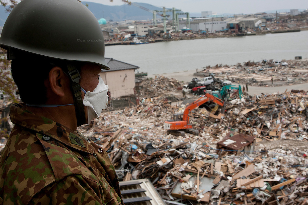 Soldiers from the Japanese Self Defense Forse (JSDF) take part in clean up operations in Ishinomaki that was badly affected by the earthquake and tsunami that struck on March 11th.  Ishinomaki, Miyagi, Japan. Friday May 6th 2011