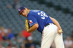 March 26, 2018 - Arlington, TX, U.S. - ARLINGTON, TX - MARCH 26: Texas Rangers starting pitcher Doug Fister (38) checks first base during the exhibition game between the Cincinnati Reds and Texas Rangers on March 26, 2018 at Globe Life Park in Arlington, TX. (Photo by Andrew Dieb/Icon Sportswire) (Credit Image: © Andrew Dieb/Icon SMI via ZUMA Press)