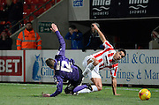 Cheltenham's Troy Brown and Morecambe's Paul Mullin during the Sky Bet League 2 match between Cheltenham Town and Morecambe at Whaddon Road, Cheltenham, England on 16 January 2015. Photo by Alan Franklin.