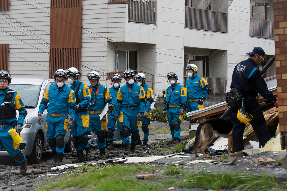 KUMAMOTO, JAPAN - APRIL 18: Police with k9 dog continue to search missing bodies on April 18, 2016 Monday in Minamiaso, Kumamoto, Japan. The magnitude 7.3 earthquake hit Kyushu, just after the earthquake killed 9, at least 26 new fatalities by this earthquake, total death toll from the series of earthquake rises to 42.<br /> <br /> Photo: Richard Atrero de Guzman