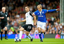 LONDON, ENGLAND - Sunday, September 13, 2009: Everton's captain Phil Neville and Fulham's Clint Dempsey during the Premiership match at Craven Cottage. (Photo by David Rawcliffe/Propaganda)