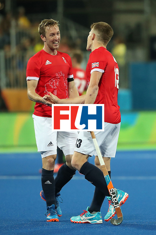 RIO DE JANEIRO, BRAZIL - AUGUST 09:  Alastair Brogdon #11 and Sam Ward #13 of Great Britain celebrate after defeating Brazil in the hockey game on Day 4 of the Rio 2016 Olympic Games at the Olympic Hockey Centre on August 9, 2016 in Rio de Janeiro, Brazil.  (Photo by Christian Petersen/Getty Images)