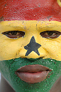 Ghanian supporter painted with the national flag across his face..Ghana, West Africa, Africa.© Demelza Cloke