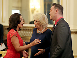 December 23, 2017 - London, London, United Kingdom - Image licensed to i-Images Picture Agency. 22/12/2017. London, United Kingdom. The Duchess of Cornwall, President of the National Osteoporosis Society, talks to 'Strictly Come Dancing' judges Shirley Ballas (left) and Craig Revel Horwood as she hosts a tea dance at Buckingham Palace in London attended by 'Strictly Come Dancing' dancers and judges to highlight the benefits for older people of staying active. (Credit Image: © Rota/i-Images via ZUMA Press)