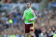 Burnley striker (formerly Brighton striker) Ashley Barnes (30) warming up during the Sky Bet Championship match between Brighton and Hove Albion and Burnley at the American Express Community Stadium, Brighton and Hove, England on 2 April 2016.