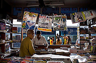 Passengers disembark to buy magazines and food during a 15 minute stop at Nagpur station, Maharashtra...Train passengers on the Himsagar Express 6318 going from Jammu Tawi station to Kanyakumari on 8th July 2009.. .6318 / Himsagar Express, India's longest single train journey, spanning 3720 kms, going from the mountains (Hima) to the seas (Sagar), from Jammu and Kashmir state of the Indian Himalayas to Kanyakumari, which is the southern most tip of India...Photo by Suzanne Lee / for The National