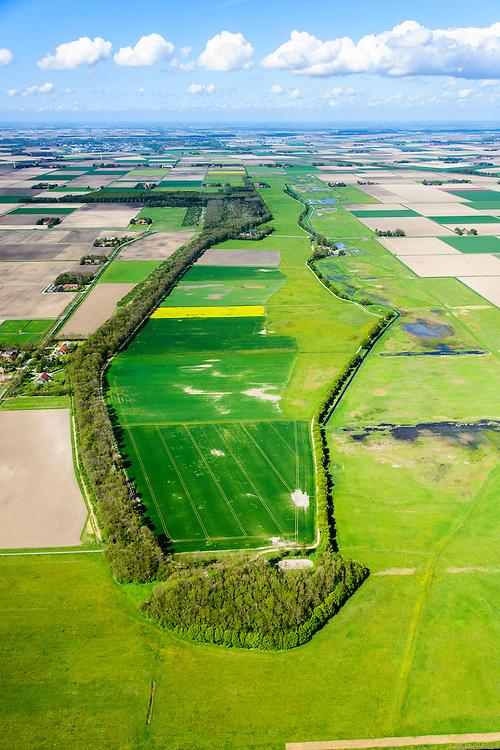 Nederland, Flevoland, Noordoostpolder, 07-05-2015; Schokland, dorp en voormalig eiland in de Zuiderzee, gezien vanuit het Zuiden. Onderdeel van de UNESCO Werelderfgoedlijst. Het verlagen van de grondwaterspiegel in de Noordoostpolder leidt tot inklinking waardoor het eiland steeds lager komt te liggen. Om verder wegzinken te voorkomen een hydrologische zone aangelegd.<br /> Village and former island, seen from the south. Part of the UNESCO World Heritage List.<br /> Lowering the groundwater level in the Noordoostpolder leads to subsidence and causes the island the sink away. In order to prevent further decline a hydrological zone has been created.<br /> luchtfoto (toeslag op standard tarieven);<br /> aerial photo (additional fee required);<br /> copyright foto/photo Siebe Swart
