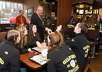 Michael Lepene and Larry Johnston serve up breakfast at McDonald's to celebrate the Gilford High School 2015 State Championship girls Volleyball team on Saturday morning.  (Karen Bobotas/for the Laconia Daily Sun)
