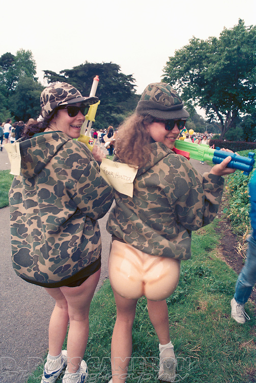 """A pair of Oakland, Calif. women who identified themselves as """"Rear Hunters,"""" search for their prey at the 84th running of the Bay to Breakers 12K race, Sunday, May 21, 1995 in San Francisco. (Photo by D. Ross Cameron)"""