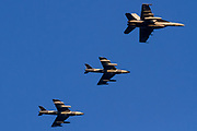 A US Navy F18 Hornet and two old Hawker Hunter Mark 58s flying for the Airborne Tactical Advantage Company (ATAC) flying over Kanagawa, Japan. Tuesday February 13th 2018 ATAC is a private company that is contracted to provide flight train and other support roles for the US Military.