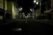 Empty streets at night in the town of Tomioka, Futaba District of Fukushima, Japan. Monday April 29th 2013. The town was evacuated on March 12th after the March 11th 2011 earthquake and tsunami cause meltdowns at the nearby Fukushima Daichi nuclear power station. It lies well within the 20 kms exclusion zone though parts of the town have recently been opened again to allow locals to visit their property during daylight hours.