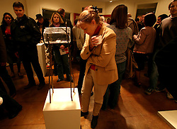 04 February, 2006. New Orleans, Louisiana.<br /> Art and money returns to the city with a Saturday night art walk in Uptown New Orleans. Wealthier residents from one of the city's more affluent neighbourhoods contemplate art at the Cole Pratt Gallery on Magazine Street.<br /> Photo; Charlie Varley/varleypix.com