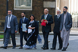 "London, July 30th 2014. Representatives from the Federation of Muslim Organisations from Leicestershire accompanied by Keith Vaz MP, Leicester East, deliver a ""Palestinian Peace Flag"" signed by hundreds, calling on the Prime Minister to help encourage an immediate ceasefire in the Israeli-Palestinian conflict."