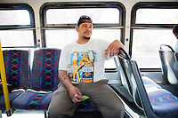 Jason Hill rides on one of two buses that take him to work Friday, July 24, 2015 in Spokane, Wash.