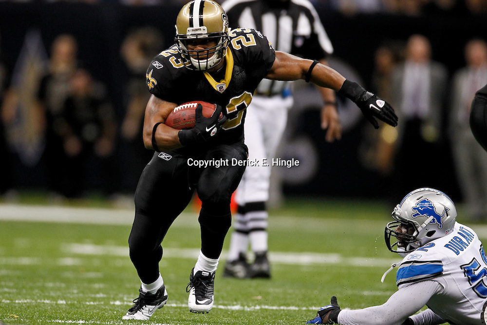 January 7, 2012; New Orleans, LA, USA; New Orleans Saints running back Pierre Thomas (23) runs from Detroit Lions linebacker Justin Durant (52) during the 2011 NFC wild card playoff game at the Mercedes-Benz Superdome. Mandatory Credit: Derick E. Hingle-US PRESSWIRE
