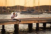 Children playing on Valentine Jetty, Lake Macquarie, NSW, Australia