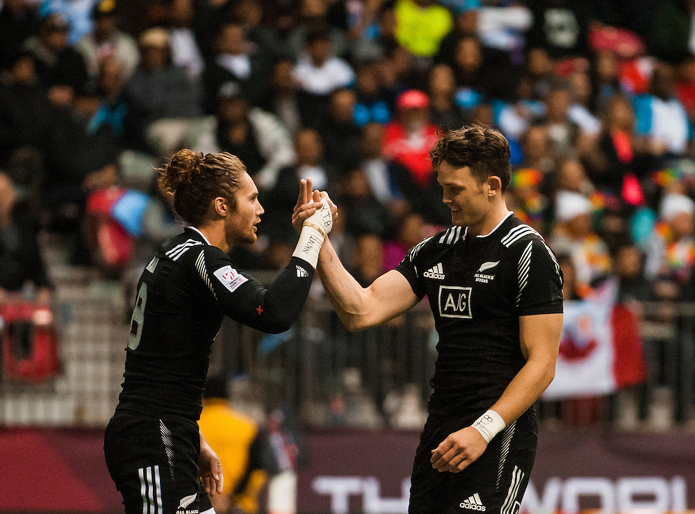 Tim Mikkelson of New Zealand is congratulated by teammate Lewis Ormond after scoring against Samoa in the Cup Quarter Final during the knockout stages of the 2016 Canada Sevens leg of the HSBC Sevens World Series Series at BC Place in  Vancouver, British Columbia. Sunday March 13, 2016.<br /> <br /> Jack Megaw<br /> <br /> www.jackmegaw.com<br /> <br /> 610.764.3094<br /> jack@jackmegaw.com