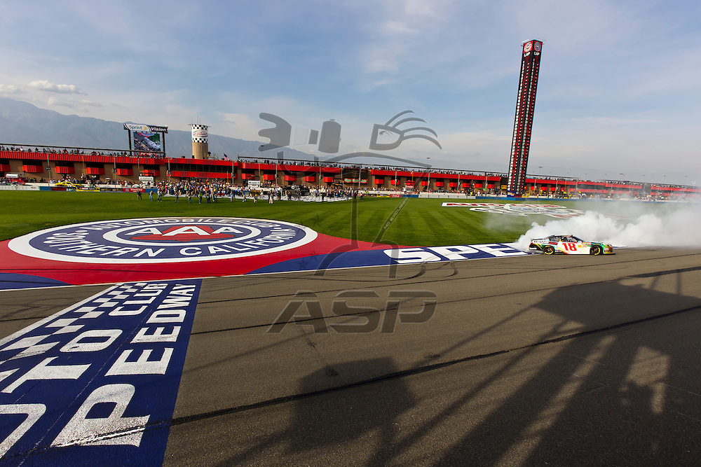 FONTANA, CA - MAR 24, 2012:  The NASCAR Nationwide teams take to the track for the Royal Purple 300 at the Auto Club Speedway in Fontana, CA.