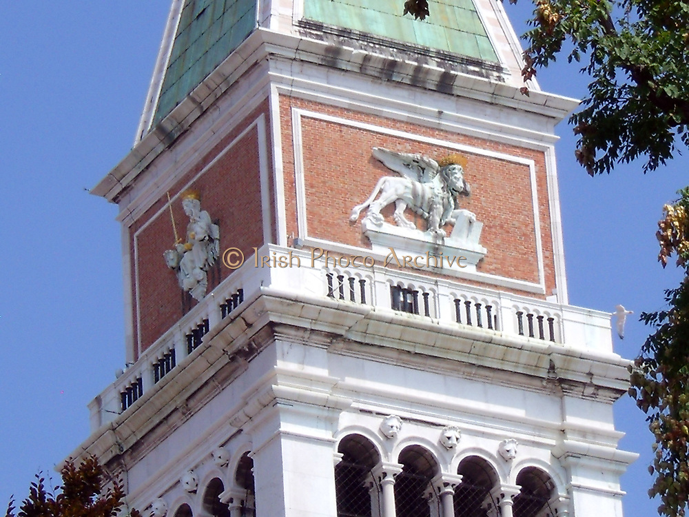 St Mark's Campanile, the bell tower of St Mark's in Venice, Italy. The tower is 98.6 metres (323 ft) tall, at the top, sits a golden weathervane in the form of the archangel Gabriel. The campanile reached its present form in 1514. The current tower constructed in its present form in 1912 after the collapse of 1902.