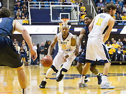Nov 20, 2016; Morgantown, WV, USA; West Virginia Mountaineers guard Jevon Carter (2) drives around a screen during the second half against the New Hampshire Wildcats at WVU Coliseum. Mandatory Credit: Ben Queen-USA TODAY Sports