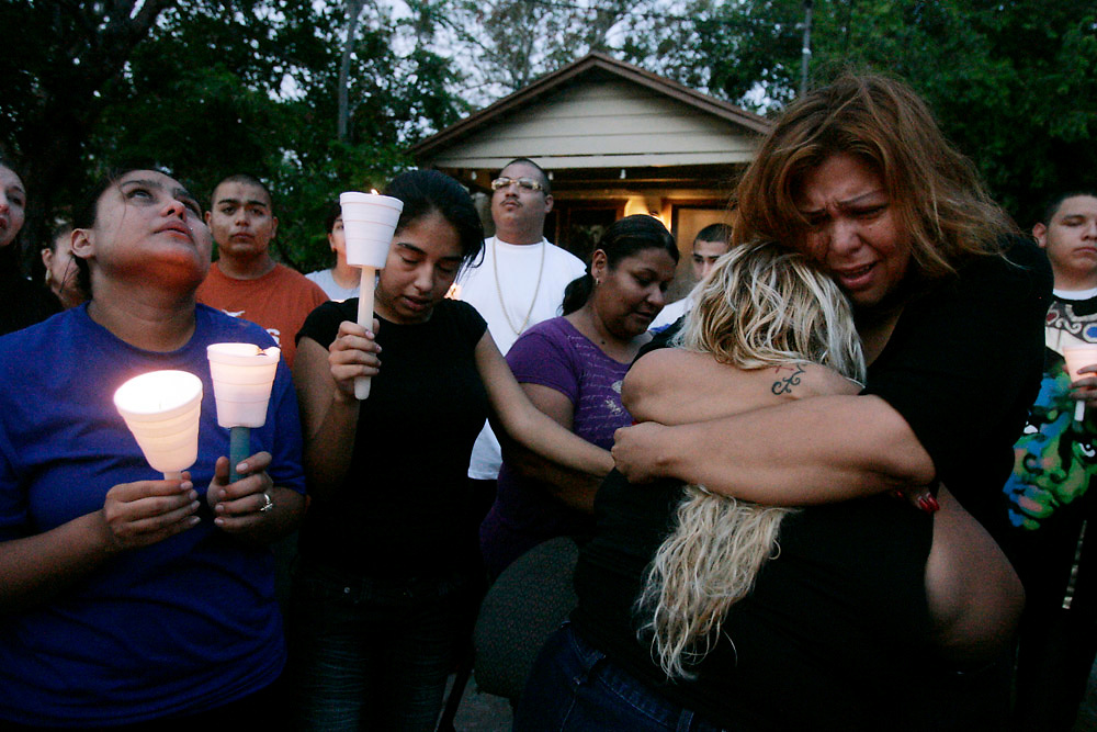 "Michael Zamora/Caller-Times.Hope Plazola (right) tries to console Sylvia Hernandez, the mother of the victim Thursday, Oct. 1, 2009 during a candlelight vigil for 17-year-old Clarryssa ""Debo"" Silguero on Sabinas Street in Corpus Christi."