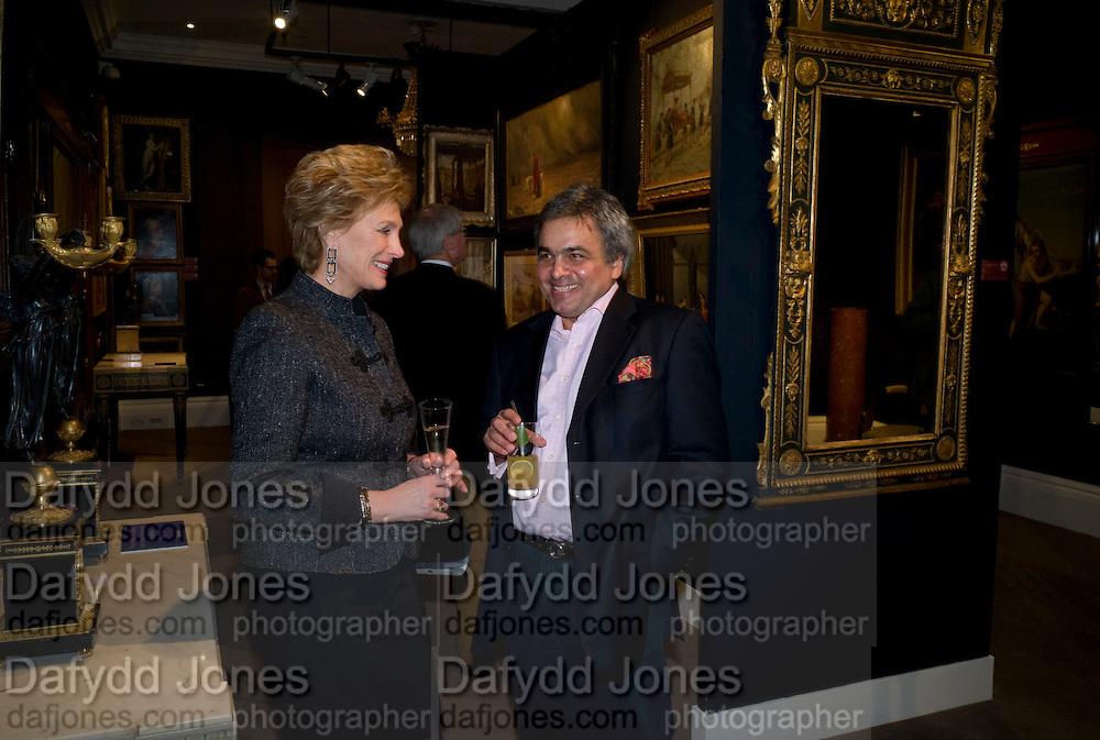 VIVIEN MCLEAN; BALDASSARE LA RIZZA. Preview party for the Versace Sale.  The contents of fashion designer Gianni Versace's villa on Lake Como. Sothebys. Old Bond St. London. 16 March 2009.  *** Local Caption *** -DO NOT ARCHIVE -Copyright Photograph by Dafydd Jones. 248 Clapham Rd. London SW9 0PZ. Tel 0207 820 0771. www.dafjones.com<br /> VIVIEN MCLEAN; BALDASSARE LA RIZZA. Preview party for the Versace Sale.  The contents of fashion designer Gianni Versace's villa on Lake Como. Sothebys. Old Bond St. London. 16 March 2009.