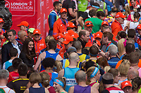 TRH The Duke and Duchess of Cambridge presenting medals to finishers on The Mall. The Virgin Money London Marathon, 23rd April 2017.<br /> <br /> Photo: Roger Allen for Virgin Money London Marathon<br /> <br /> For further information: media@londonmarathonevents.co.uk