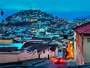 Calle de Cotopaxi rises and falls in the precipitous steep streets of the elevated Spanish colonial Andes capitol of Quito Ecuador