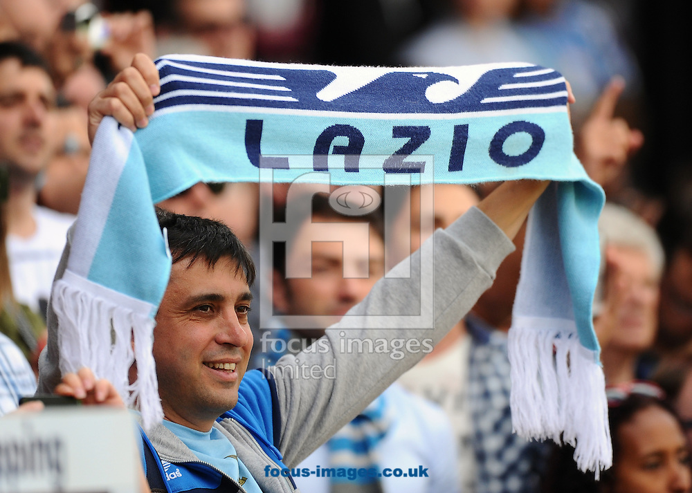 Picture by Seb Daly/Focus Images Ltd +447738 614630<br /> 10/08/2013<br /> A Lazio fan holds up his team scarf during the Pre Season Friendly match at Selhurst Park, London.