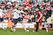 Tottenham Hotspur Midfielder, Erik Lamela (11) takes on AFC Bournemouth Midfielder, Harry Arter (8) during the Premier League match between Bournemouth and Tottenham Hotspur at the Vitality Stadium, Bournemouth, England on 22 October 2016. Photo by Adam Rivers.