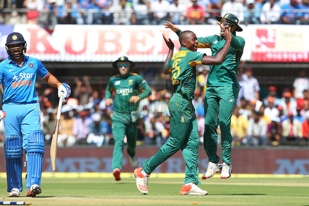 Kagiso Rabada of South Africa celebrates the wicket of Rohit Sharma of India with Farhaan Behardien of South Africa  during the 2nd Paytm Freedom Trophy Series One Day International ( ODI ) match between India and South Africa held at the Holkar Stadium in Indore, India on the 14th October 2015<br /> <br /> Photo by Ron Gaunt/ BCCI/ Sportzpics