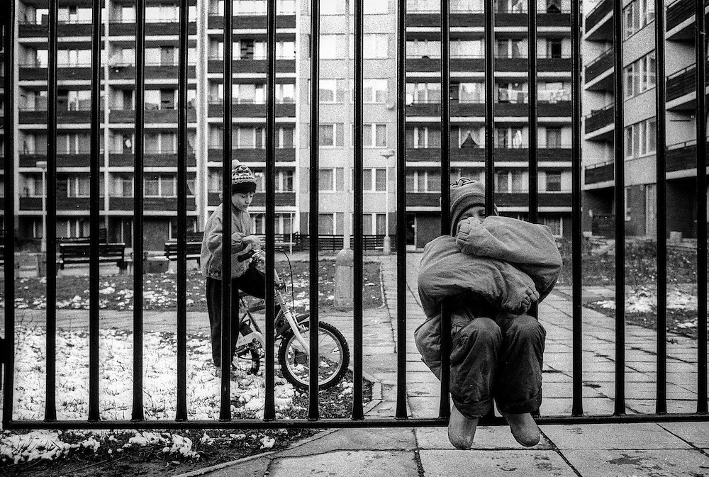 Children outside in an area with highrise buildings in Zizkov.