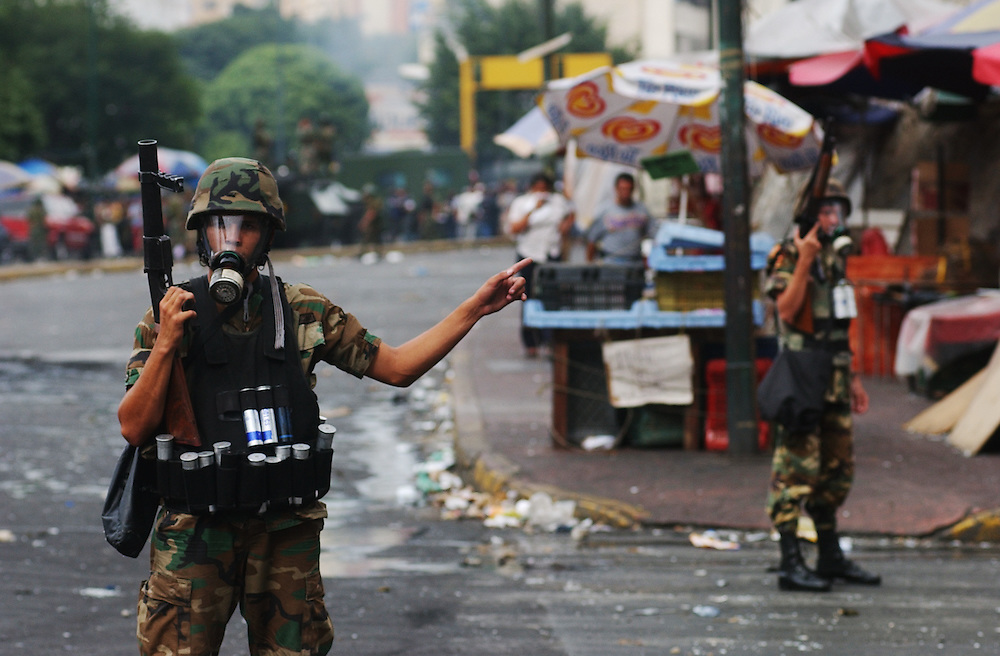 Members of the army patrol after a riot between Chavez supporters and the local police froce.