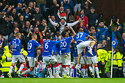 Rangers players mob Alfredo Morelos (#20) of Rangers FC after he scores the winning goal during the Europa League Play Off leg 2 of 2 match between Rangers FC and Legia Warsaw at Ibrox Stadium, Glasgow, Scotland on 29 August 2019.