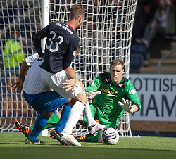 Morton's keeper Derek Gaston saves.<br />