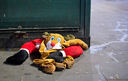 © Licensed to London News Pictures. 16/12/2016. LONDON, UK. A santa outfit is left in the street by partygoers after a night out in central London on Mad Friday, the last Friday before Christmas in the UK, which marks the start of the festive party season as many offices close for the holidays.  Photo credit: ISABEL INFANTES/LNP