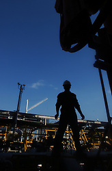PDVSA worker Juan Franco works on an off shore crude oil loading platform at the Jose complex.