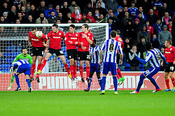 Cardiff City's Ben Turner blocks a free kick from Sheffield Wednesday's Miguel LLera - Photo mandatory by-line: Dougie Allward/Josephmeredith.com  - Tel: Mobile:07966 386802 01/12/2012 - SPORT - FOOTBALL - Championship  -  Cardiff  -  New Cardiff Stadium  -  Cardiff City V Sheffield Wednesday