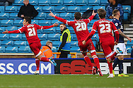 Jelle Vossen of Middlesbrough (left) celebrates scoring the opening goal against Millwall during the Sky Bet Championship match at The Den, London<br /> Picture by David Horn/Focus Images Ltd +44 7545 970036<br /> 06/12/2014