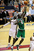 May 1, 2010; Cleveland, OH, USA; Boston Celtics forward Kevin Garnett (5) shoots over Cleveland Cavaliers forward LeBron James (23) during the third quarter of game one in the eastern conference semifinals in the 2010 NBA playoffs at Quicken Loans Arena. The Cavaliers beat the Celtics 101-93. Mandatory Credit: Dave Miller-US PRESSWIRE