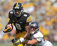 September 07 2013: Iowa Hawkeyes wide receiver Don Shumpert (8) is pulled down by Missouri State Bears safety Caleb Schaffitzel (34) after a catch during the third quarter of the NCAA football game between the Missouri State Bears and the Iowa Hawkeyes at Kinnick Stadium in Iowa City, Iowa on September 7, 2013. Iowa defeated Missouri State 28-14.
